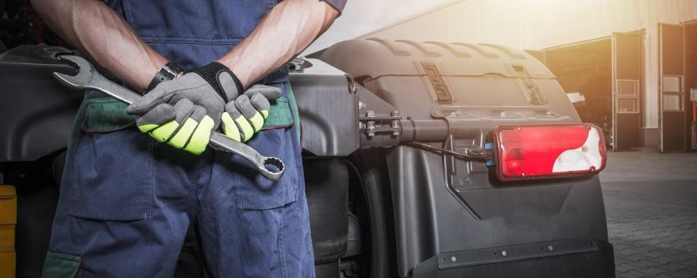 Semi Trucks Mechanic with Large Wrench