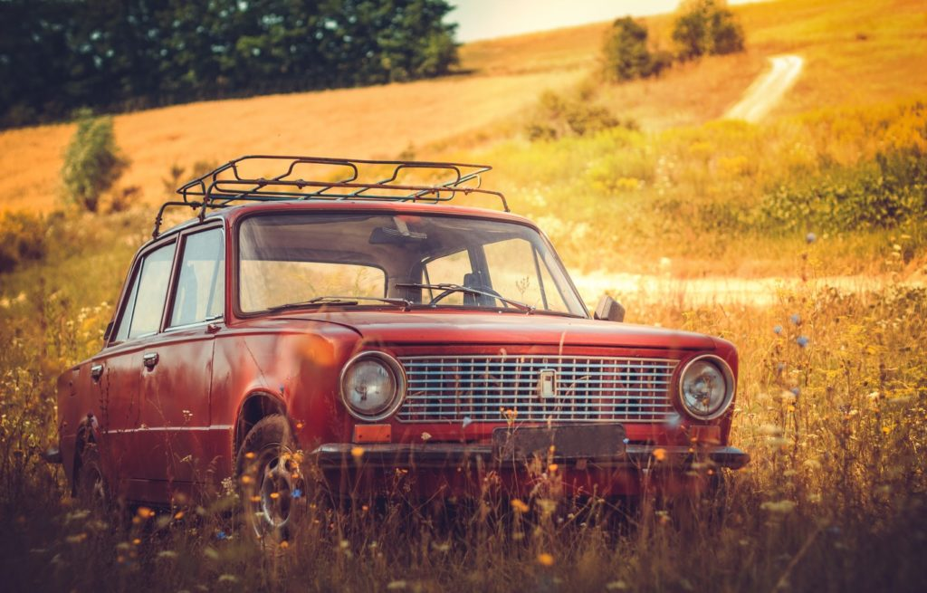 car parked in country field